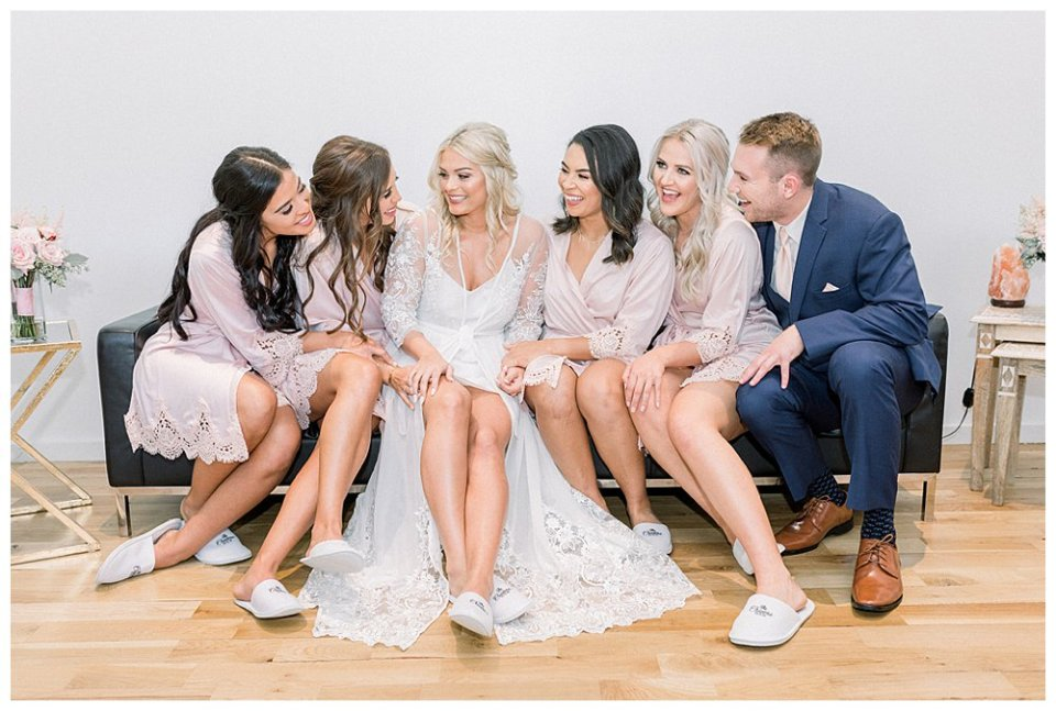 Bride with bridesmaids while getting ready