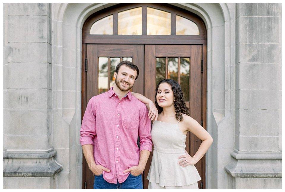 Girl leaning on guy in front of door