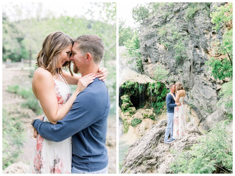 Couple embracing on rock in front of waterfall in Turner Falls engagement session