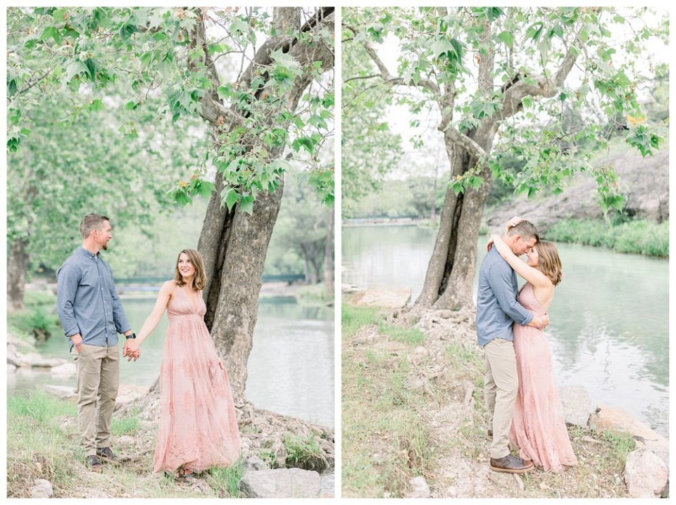 Couple embracing next to tree in Turner Falls engagement