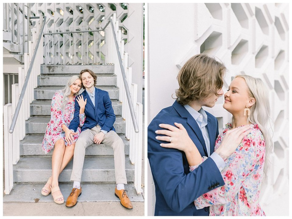 Couple cuddling on steps in front of white brick wall  in Guthrie Green / Centennial Park Tulsa engagement