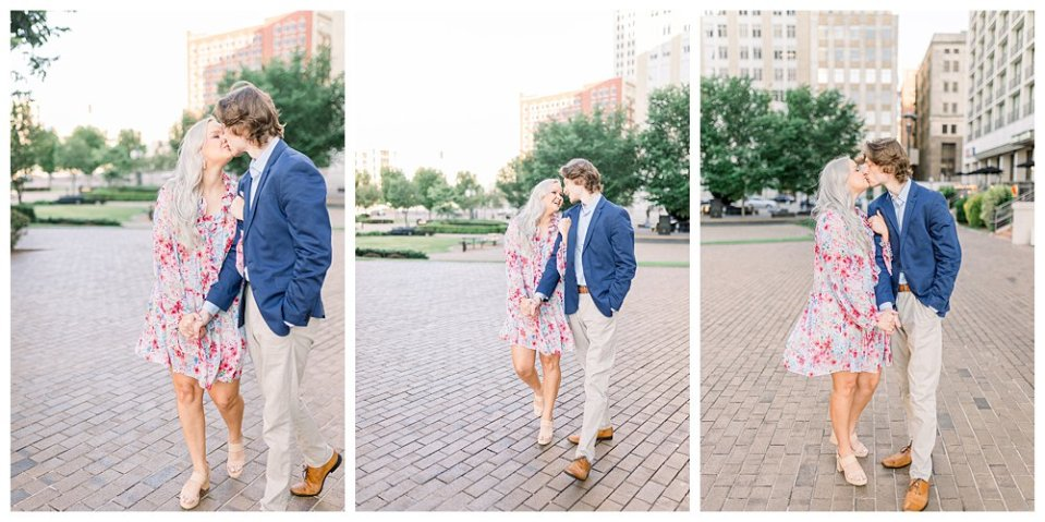 Couple walking and kissing on brick path  in Guthrie Green / Centennial Park Tulsa engagement