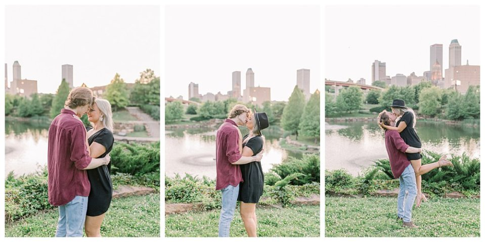 Couple kissing in front of city scape Tulsa Centennial Park engagement