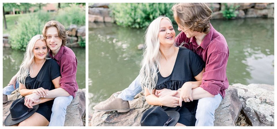 Couple cuddling and laughing on rock by pond  in Guthrie Green / Centennial Park Tulsa engagement