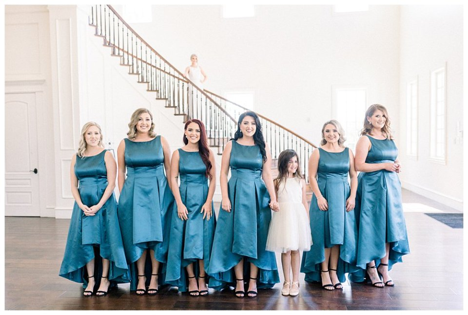 bridesmaids getting ready to see bride in dress for first time