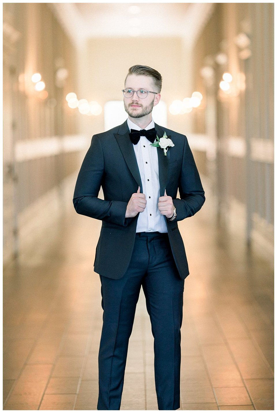 Groom standing in hallway at the Milestone Mansion