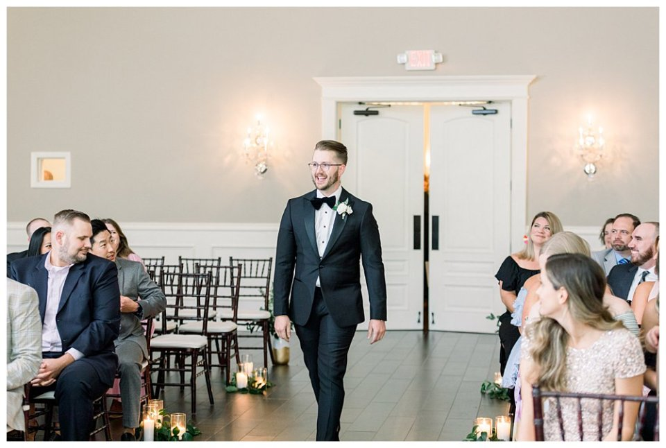 Groom walking up to alter for wedding ceremony