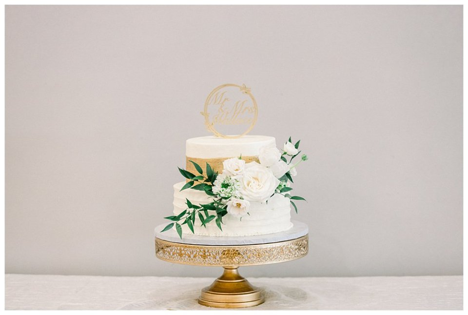 2 tiered white and gold wedding cake