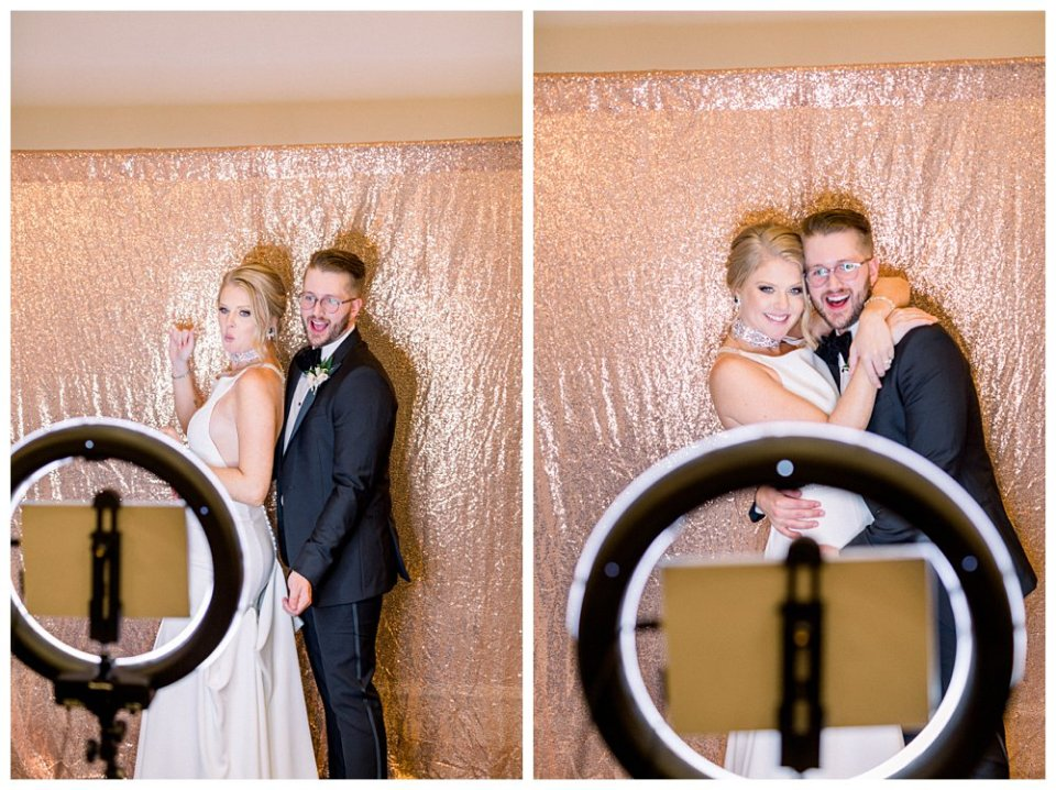 Bride and groom taking pictures in photo booth