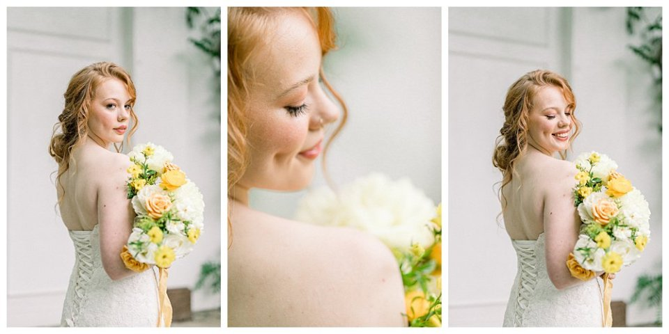 Bride looking over shoulder holding white and yellow bridal bouquet