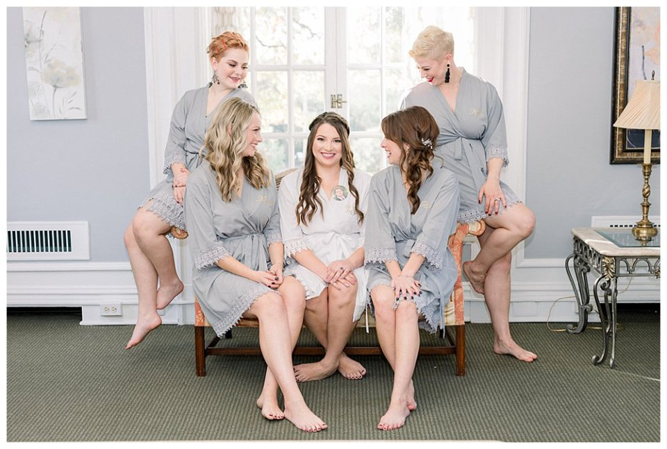 bride sitting with bridesmaids Mansion at Woodward Park elopement Stunning  Timeless Tulsa Photographer