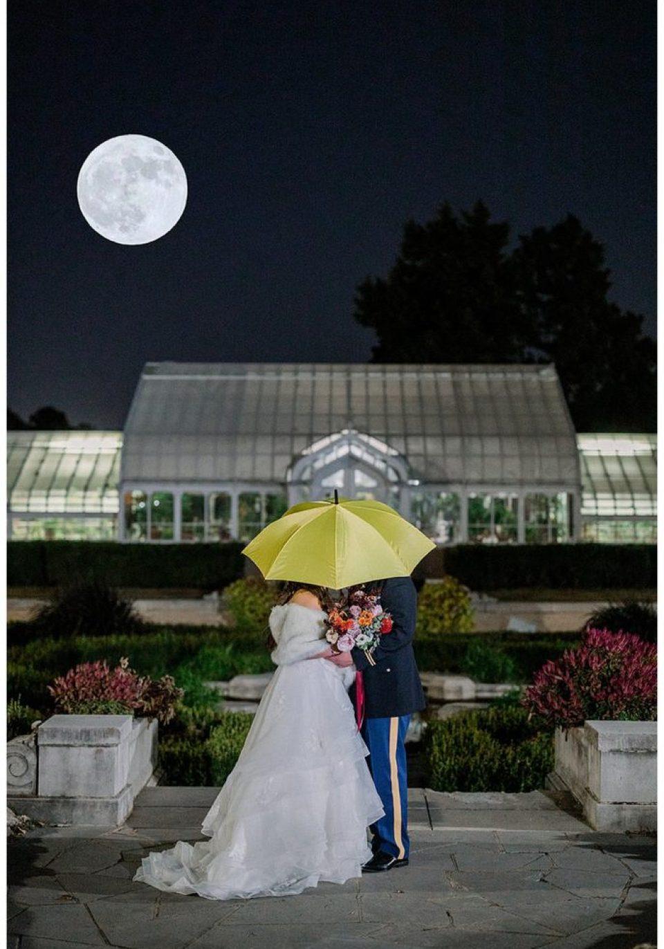 Bride and groom kissing under umbrella Wedding Stunning Tulsa Photographer