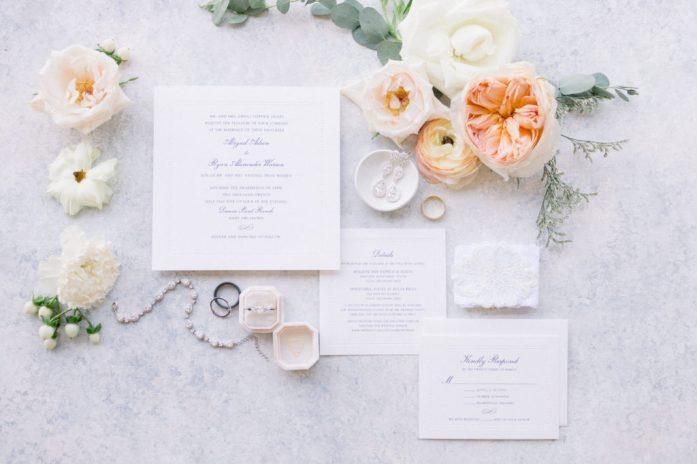 Elegant detail shots of flowers, diamonds, and wedding invitations