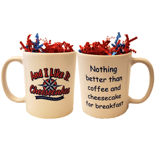 "Twelve ounce white coffee mug with the And I Like It logo printed on front and quote ""Nothing better than coffee and cheesecake for breakfast"" on the back."