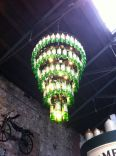 Amazing chandelier made with Jameson bottles.