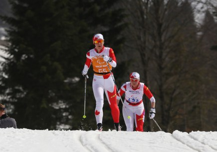 Racing with Margarita Gorbounova at the Sochi Paralympic Games.