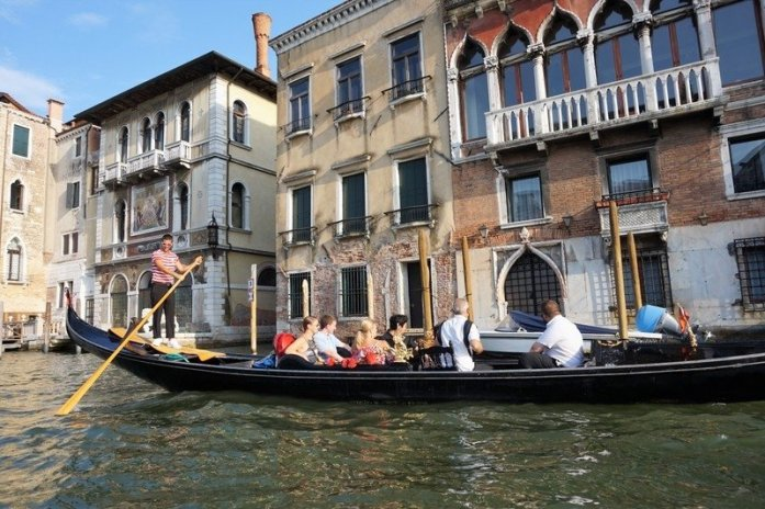 Taking a Romantic Gondola Ride in Venice, Italy
