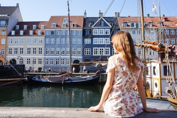 Nyhavn is a popular waterfront area in Copenhagen, Denmark, lined with lots of restaurants and colourful buildings and is a must-visit as part of a two-day Copenhagen itinerary.