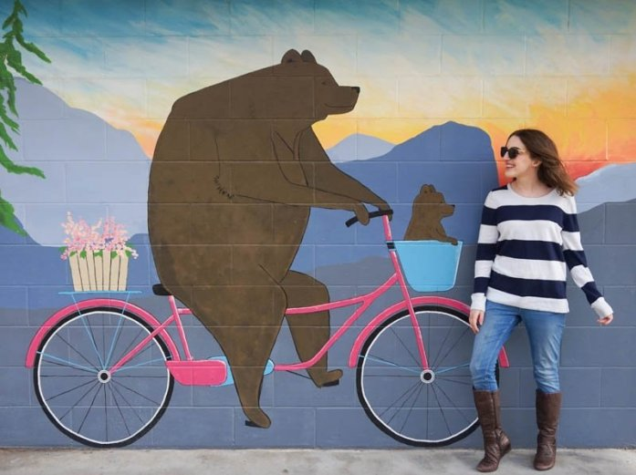 Tickleberry's mural at Skaha Beach in Penticton with a bear riding a bicycle