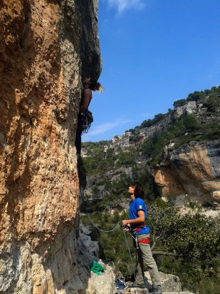 Warm up in Siuranella Est, Walker Emerson belaying Colette on a classic 7a
