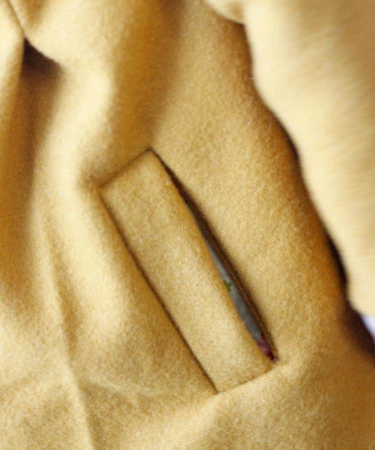 yellow wool coat welt pocket.
