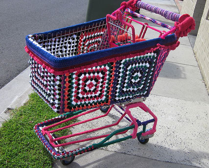 yarn bombed shopping cart