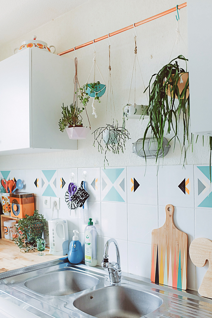 hang a copper rod in the kitchen