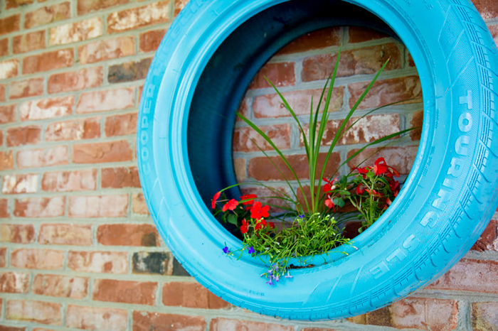 fun upcycled tire planter for your outdoor garden