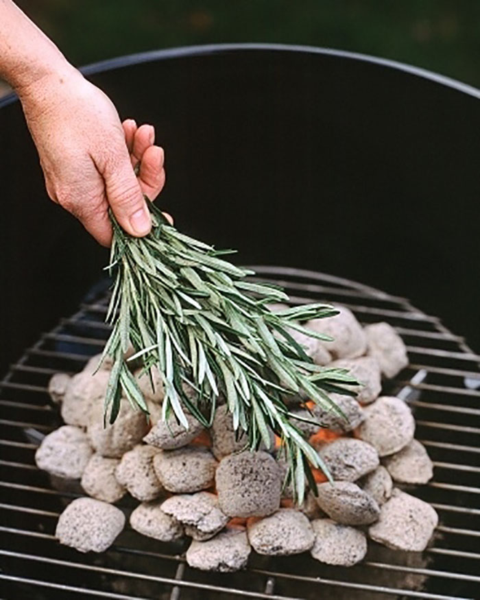 Put herbs on the coals to flavor meat without a marinade