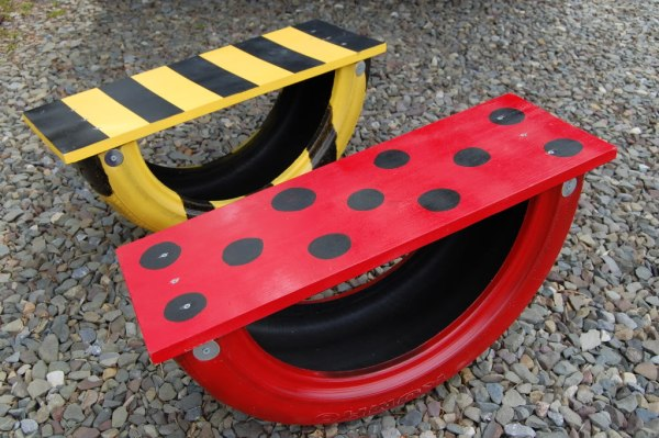 Turn an old tire into sweet tire seesaws