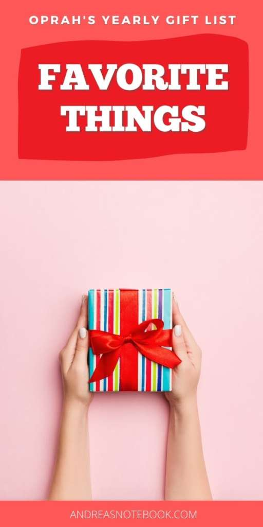 colorful striped gift with red ribbon on pink background