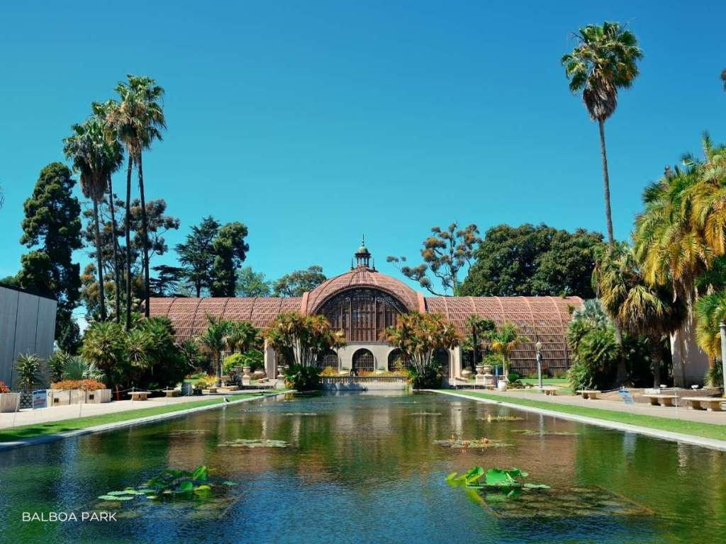 building at balboa park with square water pond in front