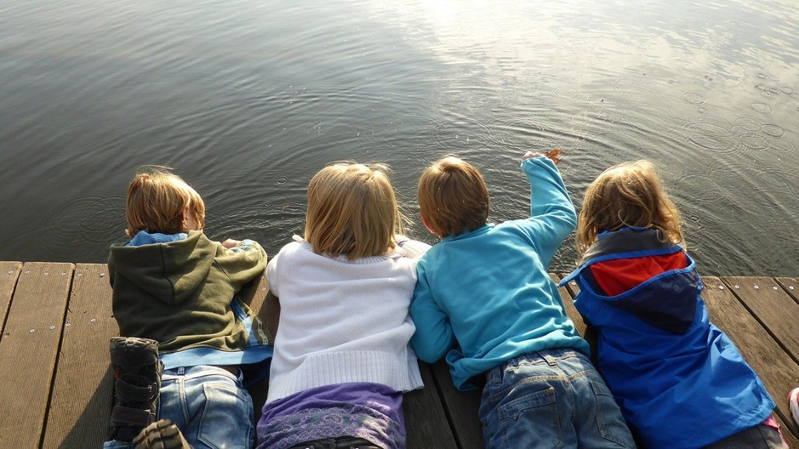 children on dock