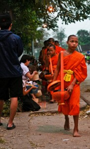 giving alms to Buddhist monks, early morning in Luang Prabang