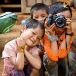 portrait of children discovering photography (Myanmar, 2011)