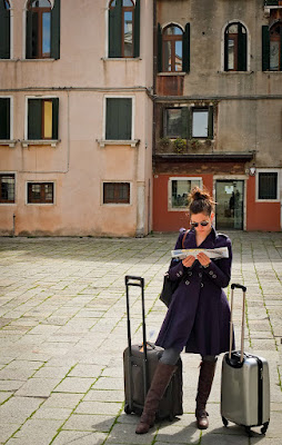 tourist looking lost in Venice - with map and suitcases