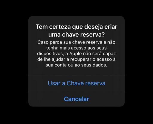 A imagem mostra uma mensagem de sistema do iOS, que diz: Tem certeza que deseja criar uma chave reserva? Caso perca sua chave reserva e não tenha mais acesso aos seus dispositivos, a Apple não será capas de lhe ajudar a recuperar o acesso à sua conta ou ao seus dados.