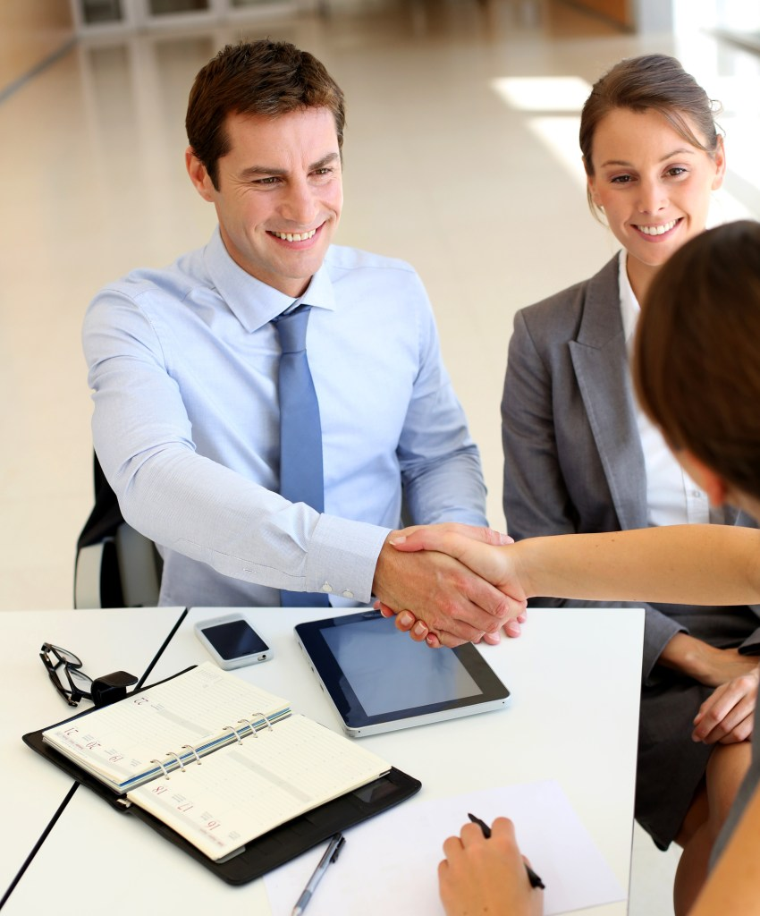 Motivated Employees Shaking Hands