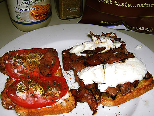 Toast bread w cheddar, slpa some mayo, tomatoes, the stir fry, and top w ricotta.