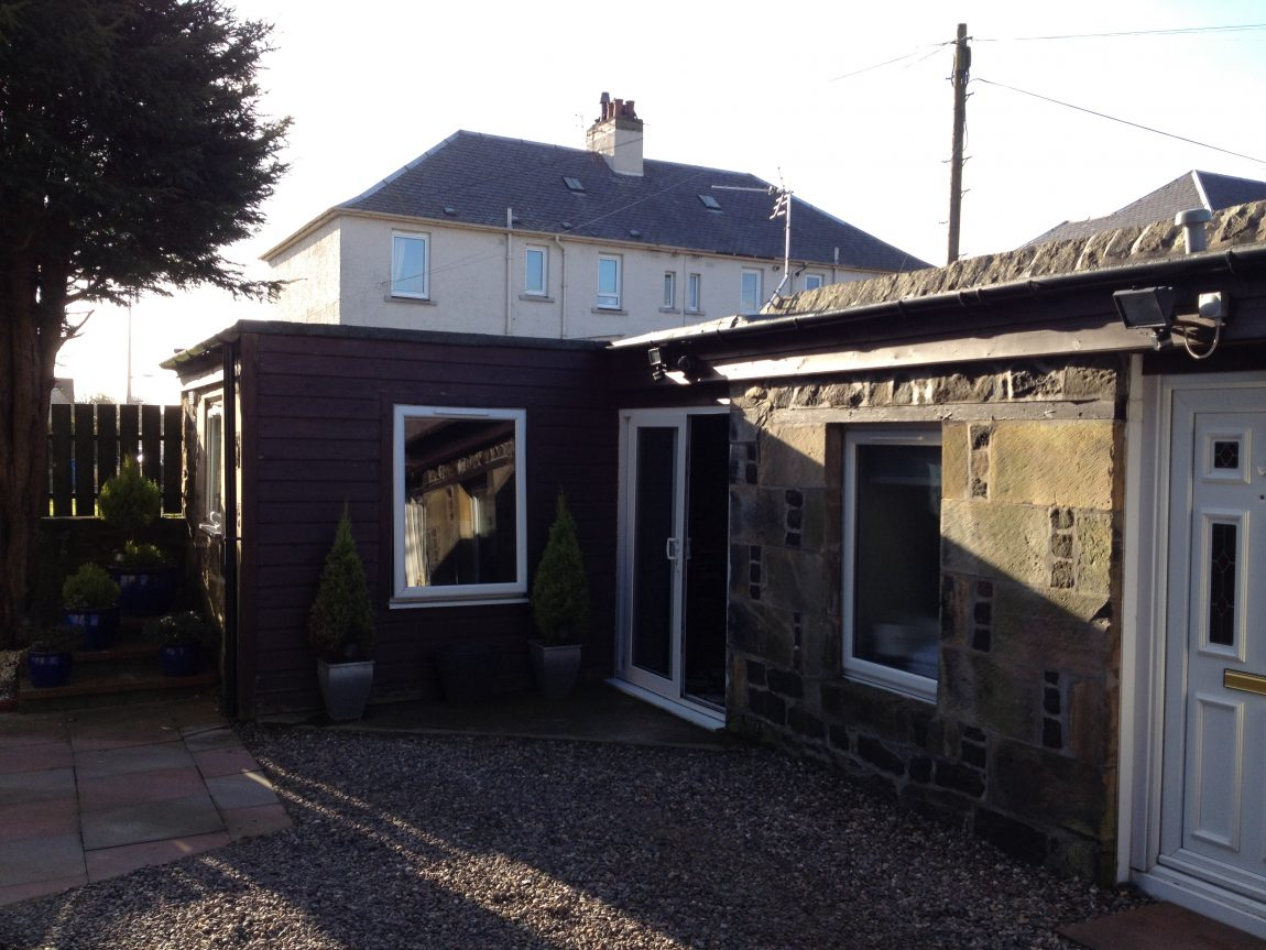 conversion and timber clad extension to outbuilding to form holiday accomodation