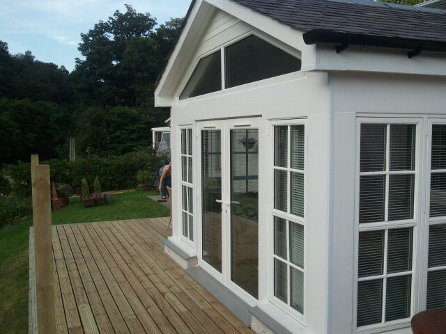 glass fronted extension facing river