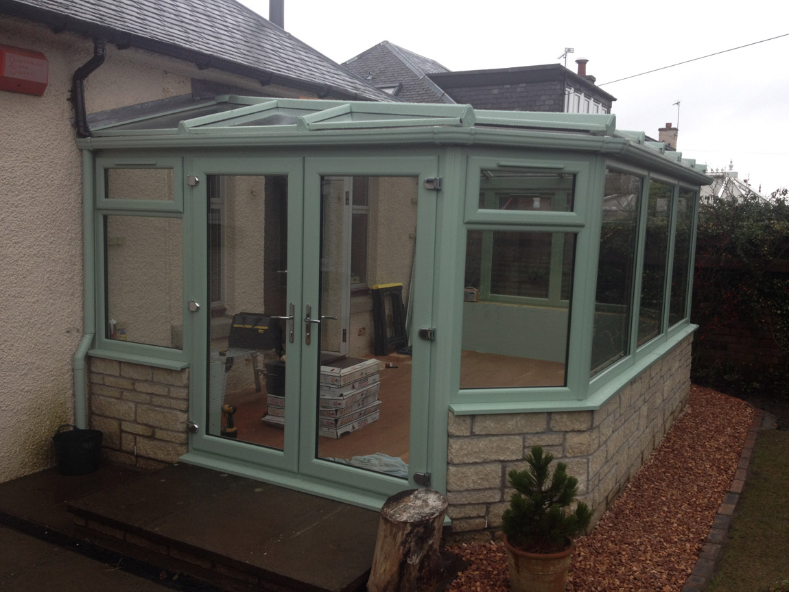 gullwing style conservatory in green