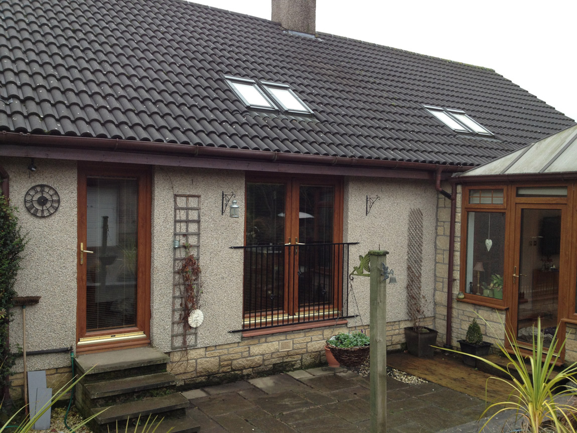 installation of 2no double Velux roof windows and cut down for french doors