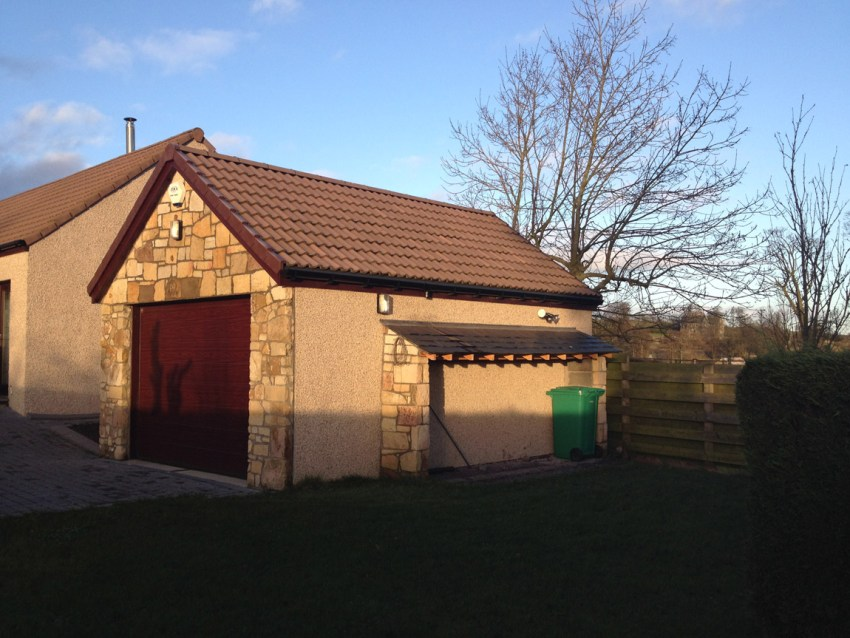 large single garage with log and bin store to side