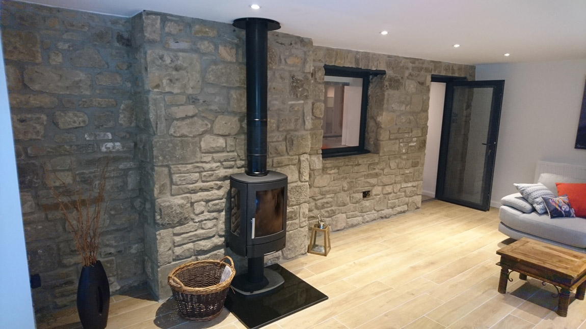 multi fuel stove centre piece within stunning extension