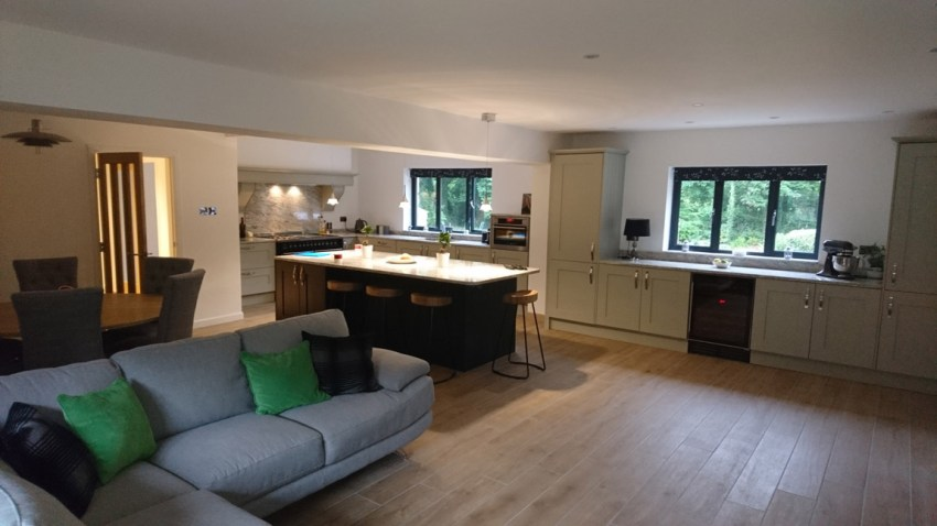 open plan kitchen - dining - family room with steel beams