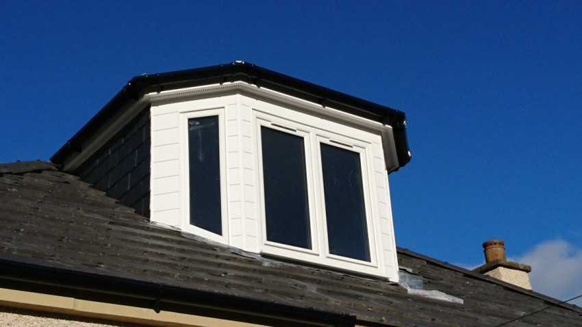 white pvcu clad dormer with slate cheeks