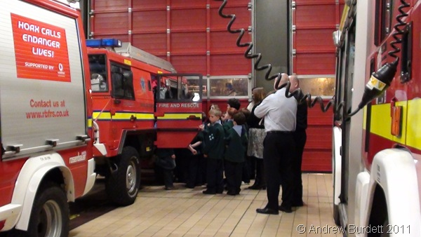 PILE 'EM IN_The Cubs squeeze into the 6*6 all-terrain mini-fire-engine.