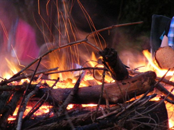 ROARING FLAME_The campfire burning, as singing and jolliness happened around it.