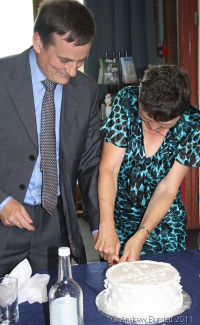 FIRST SLICE_Mum and Dad cut their wedding anniversary fruit cake.